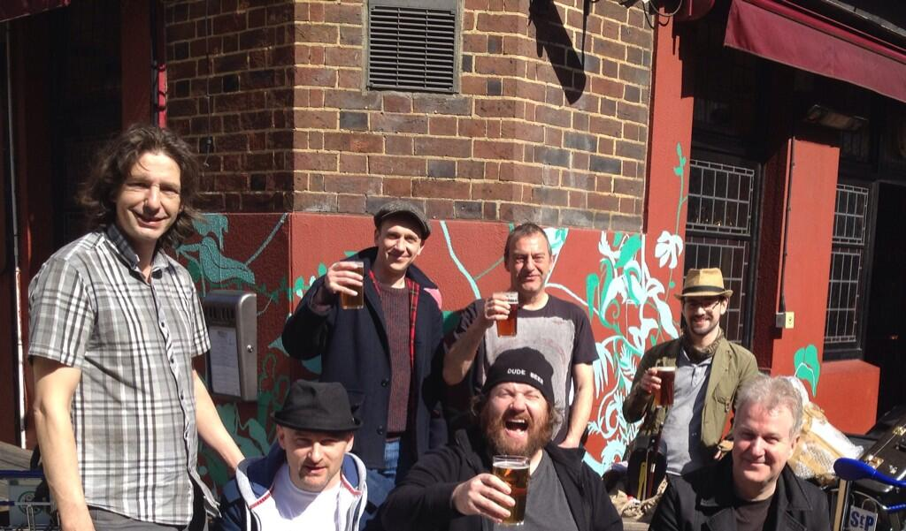 L-R MD Bill Leach, Trumpeteer Ged Fox, Chris 'ukelele' Huff, me, Jonny 'bongo' Hase, John 'no jokes' Lewis and our carer Richard enjoy a pint outside the Bree Louise, Euston Street, afore getting those borrowed trolleys back to Euston, and pouring us all onto the train back home.